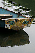 Photo Venice Canal wall art. Boat with a cat painted on the back and the reflection in the water. Matted print, limited edition. Los Angeles, Westside, Southern California landscape photography.  Fine art photography print.