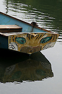 Close up of a boat painted with the face of a cat and the reflection in the water. Venice, CA 5.1.15