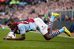 Aston Villa Forward Christian Benteke (BEL) takes a tumble - Photo mandatory by-line: Rogan Thomson/JMP - 07966 386802 - 23/03/2014 - SPORT - FOOTBALL - Villa Park, Birmingham - Aston Villa v Stoke City - Barclays Premier League.