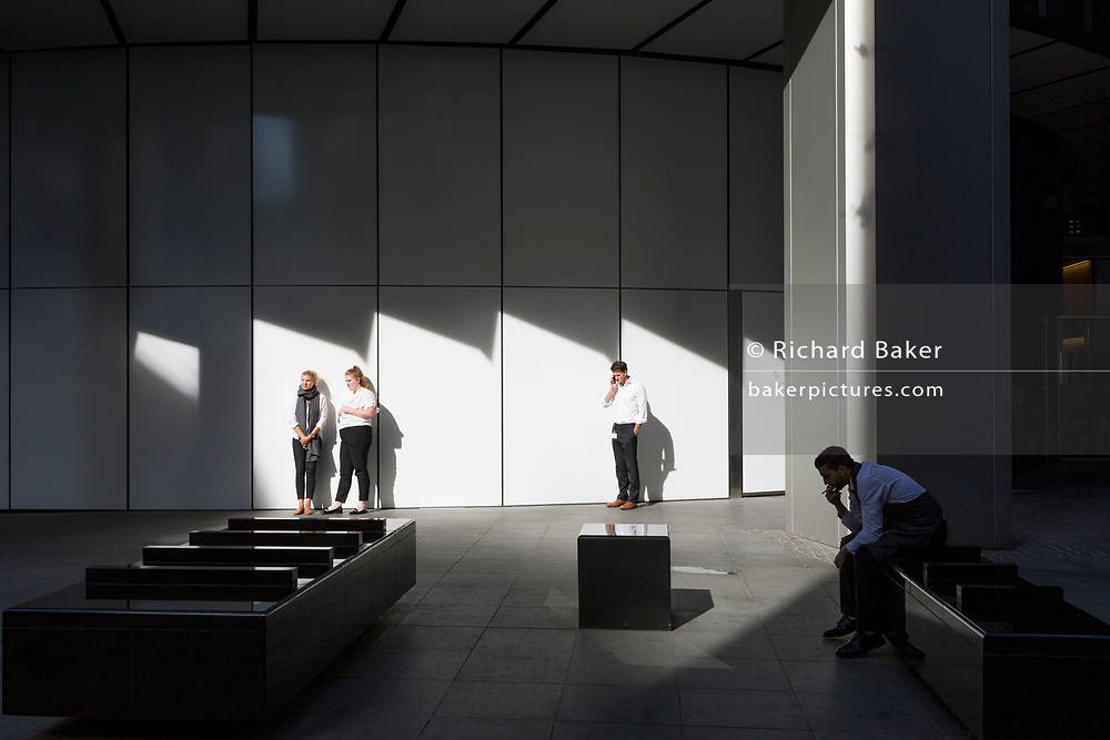 Office workers enjoy the warmth of autumnal sunshine outside the Willis Towers Watson building on Fenchurch Avenue in the heart of the capital's financial district (aka The Square Mile),  on 24th September 2018, in London, England.