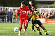 Josh Koroma of Leyton Orient (19) is hassled by Josh Falkingham of Harrogate Town (4) during the Vanarama National League match between Harrogate Town and Leyton Orient at Wetherby Road, Harrogate, United Kingdom on 22 September 2018.