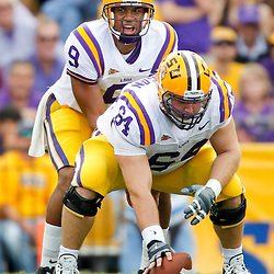 November 25, 2011; Baton Rouge, LA, USA; LSU Tigers quarterback Jordan Jefferson (9) under center P.J. Lonergan (64) during the second quarter of a game against the Arkansas Razorbacks at Tiger Stadium.  Mandatory Credit: Derick E. Hingle-US PRESSWIRE