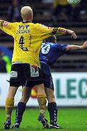 08.09.2001 Tammela stadium, Tampere, Finland. Veikkausliiga, Tampere United v Kuopion Palloseura.  Ville Lehtinen (TreU - blue) v Lassi Lehtonen (KuPS)..©JUHA TAMMINEN