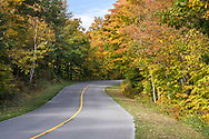 The Lac Champlain Parkway winds though the forest on a fall day in Gatineau Park.  Photographed during Fall Rhapsody at Gatineau Park in Gatineau, Québec, Canada.