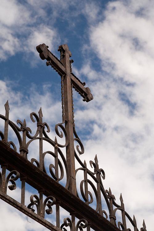 North America, Mexico, Oaxaca Province, Oaxaca, wrought-iron Christian cross above gate to church