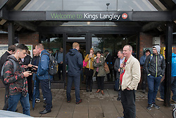 © Licensed to London News Pictures. 16/09/2016. Watford, UK.  Passengers wait to be collected outside Kings Langley rail station following the derailment by a landslide of a train bound for London Euston. Passengers were transferred to a rescue train and exited at Kings Langley.  Apart from one person who suffered whiplash, there were no other reported injuries. Photo credit : Stephen Chung/LNP