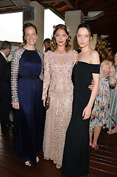 Left to right, BRITA FERNANDEZ SCHMIDT UK Executive Director Women for Women International ARIZONA MUSE and NATY CHABANENKO at The Women for Women International & De Beers Summer Evening held at The Royal Opera House, Covent Garden, London on 23rd June 2014.