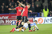 Huddersfield's Tom Ince tackled by Scott McTominay during the The FA Cup match between Huddersfield Town and Manchester United at the John Smiths Stadium, Huddersfield, England on 17 February 2018. Picture by George Franks.