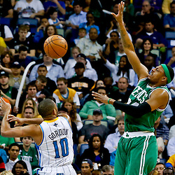 Mar 20, 2013; New Orleans, LA, USA; New Orleans Hornets shooting guard Eric Gordon (10) fouls Boston Celtics small forward Paul Pierce (34) during the second quarter of a game at the New Orleans Arena. Mandatory Credit: Derick E. Hingle-USA TODAY Sports