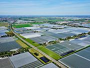 Nederland, Zuid-Holland, Bleiswijk, 14-09-2019; hogesnelheidslijn HSL doorsnijdt het kassengebied van Bleiswijk in de Overbuurtsche Polder. A12 en Zoetermeer in het verschiet.<br /> The rails of the HST between the greenhouses of the vegetables and fruit producers in the west of the Netherlands, skyline Rotterdam<br /> <br /> luchtfoto (toeslag op standard tarieven);<br /> aerial photo (additional fee required);<br /> copyright foto/photo Siebe Swart