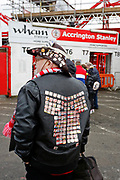 An Accrington fan with multiple badges on his jacket during the The FA Cup fourth round match between Accrington Stanley and Derby County at the Fraser Eagle Stadium, Accrington, England on 26 January 2019.