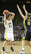 08 February 2007: Iowa forward Nicole VanderPol (43) tries to pass over Michigan forward Carly Benson (21) in Iowa's 66-49 win over Michigan at Carver-Hawkeye Arena in Iowa City, Iowa on February 8, 2007.