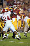 University of Southern California Trojan quarterback Matt Leinart looks down field  to pass the ball during a 70 to 17 win over the Arkansas Razorbacks on September 17, 2005 at Los Angeles Memorial Coliseum in Los Angeles, California.