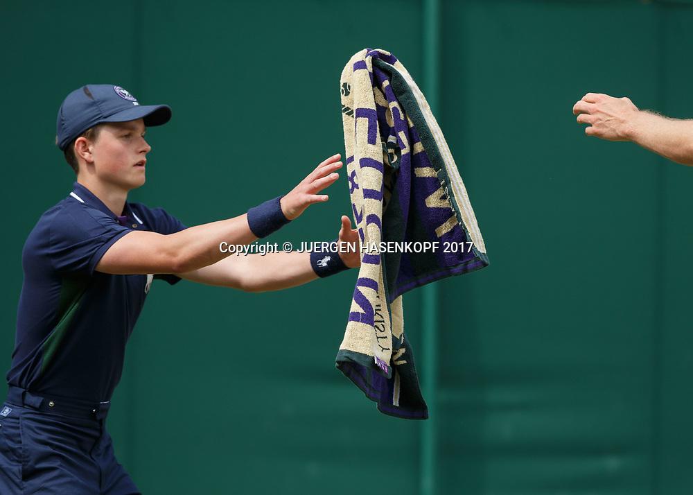 Wimbledon Feature,Balljunge faengt Handtuch,<br /> <br /> Tennis - Wimbledon 2017 - Grand Slam ITF / ATP / WTA -  AELTC - London -  - Great Britain  - 4 July 2017.
