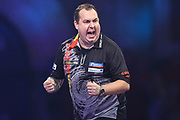 Kim Huybrechts hits a double and wins the first set against Geert Nentjes during the PDC William Hill Darts World Championship at Alexandra Palace, London, United Kingdom on 13 December 2019.