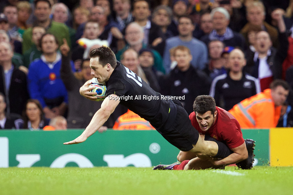 17.10.2015. Millennium Stadium, Cardiff, Wales. Rugby World Cup Quarter Final. New Zealand versus France. New Zealand fullback Ben Smith is tackled.