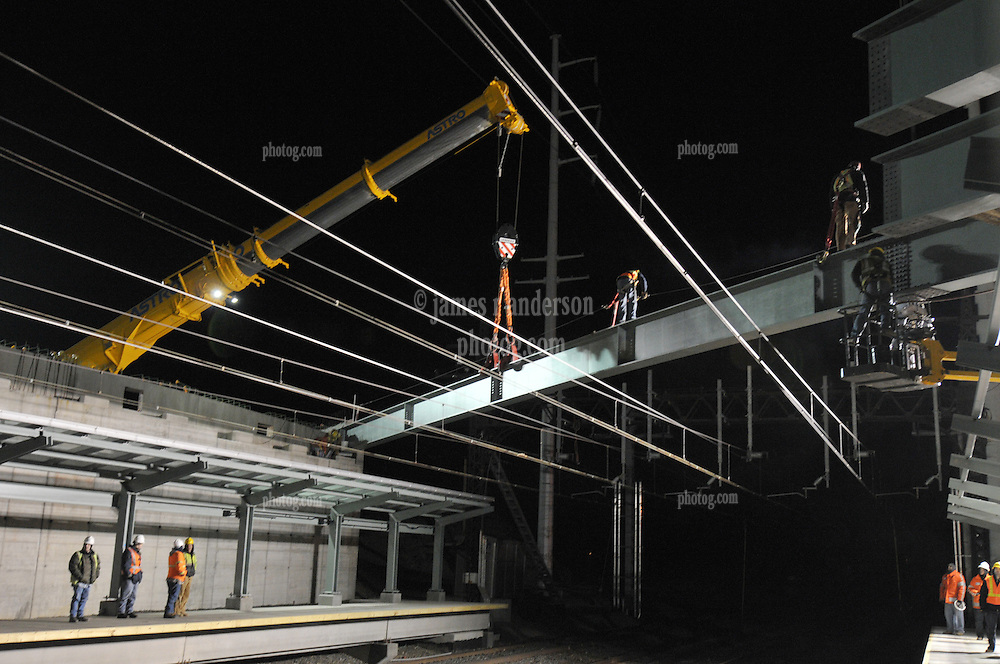 Iron Workers at Night Bridge Steel Pick over Northeast Corridor Tracks. Construction of the Railroad Station at Fairfield Metro Center, Connecticut.