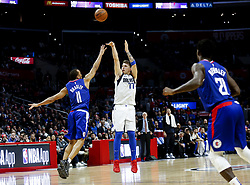 December 20, 2018 - Los Angeles, California, U.S - Dallas Mavericks' Luka Doncic (77) shoots over Los Angeles ClippersÃ• Avery Bradley (11) in an NBA basketball game between Los Angeles Clippers and Dallas Mavericks om Thursday, Dec. 20, 2018, in Los Angeles. The Clippers won 125-121. (Credit Image: © Ringo Chiu/ZUMA Wire)