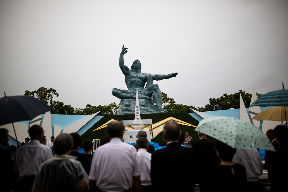 NAGASAKI, JAPAN - AUGUST 9 : Visitors pray for the atomic bomb victims in front of the Nagasaki Peace Park in Nagasaki, southern Japan on Wednesday, August 9, 2017. Japan marked the 72nd anniversary of the atomic bombing on Nagasaki. (Photo: Richard Atrero de Guzman/NUR Photo)