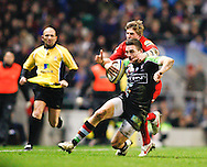 Picture by Andrew Tobin/Focus Images Ltd. 07710 761829. .27/12/11. Seb Stegmann (14) of Harlequins is tackled by David Strettle (14) of Saracens (red) during the Aviva Premiership match between Harlequins and Saracens at Twickenham Stadium, London.
