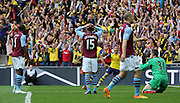 Arsenal's Theo Walcott celebrates his goal during the The FA Cup match between Arsenal and Aston Villa at Wembley Stadium, London, England on 30 May 2015. Photo by Phil Duncan.