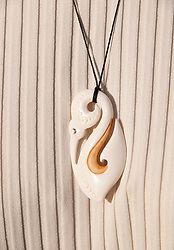 New Zealand, South Island, Marlborough,traditional Maori shark fish hook jewelry. Photo copyright Lee Foster. Photo #126325