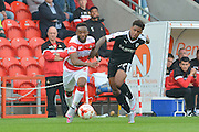 Cedric Evina  of Doncaster Rovers  and Kadeem Harris of Barnsley FC during the Sky Bet League 1 match between Doncaster Rovers and Barnsley at the Keepmoat Stadium, Doncaster, England on 3 October 2015. Photo by Ian Lyall.