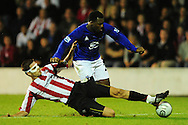 London - Tuesday, 21st September, 2010: Pim Balkestein of Brentford and Yakubu of Everton during the Carling Cup 3rd Round match at Griffin Park, London...Pic by: Alex Broadway/Focus Images