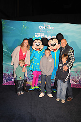 "SALLY GUNNELL and her husband JONATHAN BIGG with their children, left to right,  MARLEY, FINLEY and LUCA photographed with Micky Mouse & Minnie Mouse at a VIP Opening night of Disney & Pixar's ""Finding Nemo on Ice"" at The O2 Arena Grennwich London on 23rd October 2008."