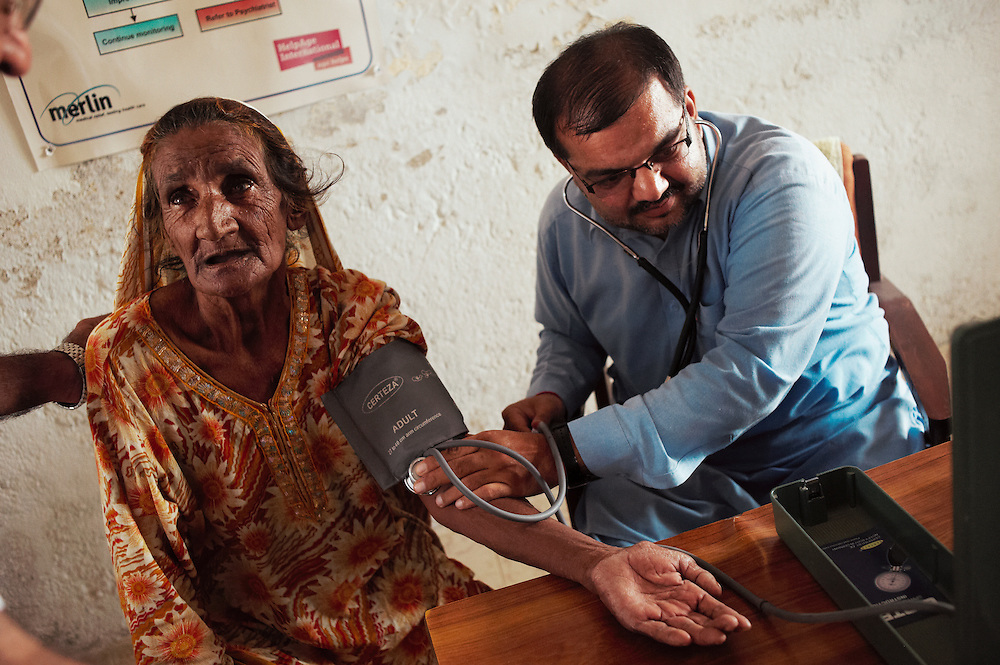 Kori Kher Muhammad, 65 years old seeks treatment from Doctor Isazeer Bughio at the Mitho Barbar government health clinic in Dadu, Sindh, Pakistan on July 4, 2011. She has high blood pressure and does not ever eat meat even on religious festivals. She says' It's no life for an older person.'