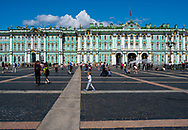 St. Petersburg, Russia -- July 21, 2019. Photo of people walking around in the square outside the Winter Palace in St Petersburg, Russia.