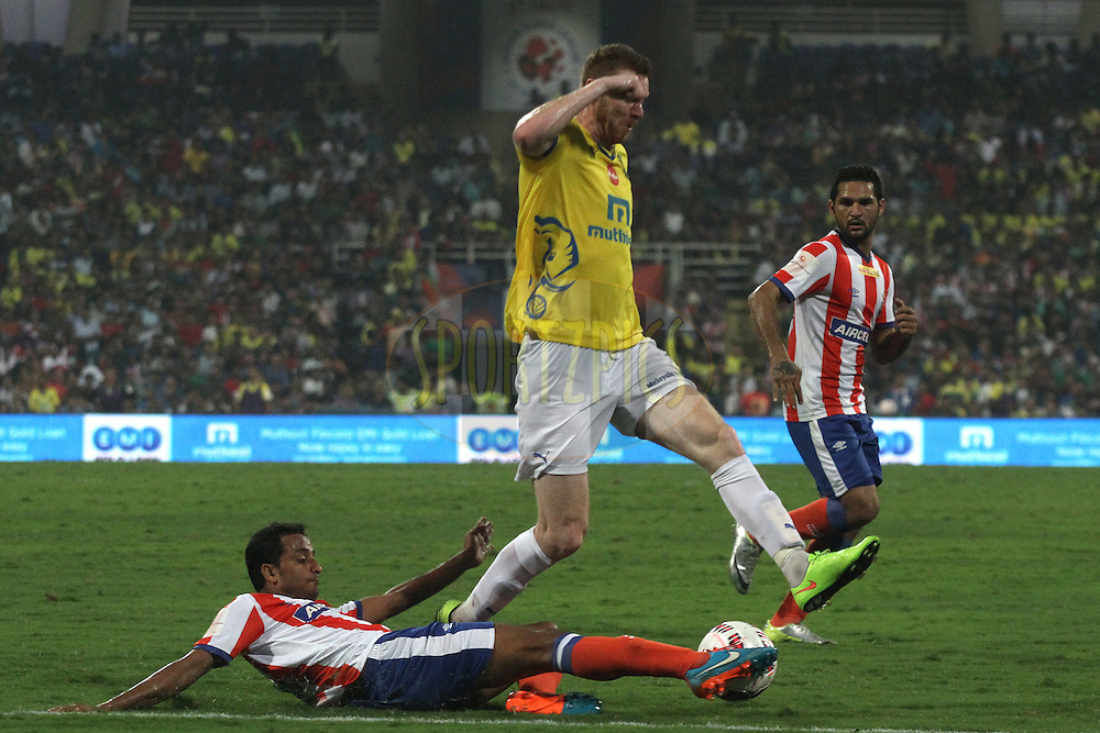 Kinshuk Debnath of Atletico de Kolkata tackles Stephen Pearson of Kerala Blasters FC during the final of the Hero Indian Super League between Kerala Blasters FC and Atletico de Kolkata held at the D.Y. Patil Stadium, Navi Mumbai, India on the 2oth December 2014.<br /> <br /> Photo by:  Shaun Roy / ISL/ SPORTZPICS