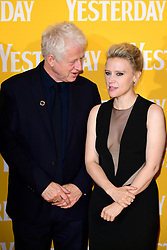 Richard Curtis (left) and Kate McKinnon attending the Yesterday UK Premiere held in London, UK.