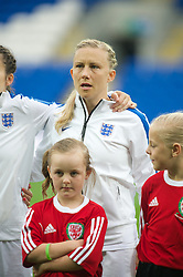 CARDIFF, WALES - Tuesday, August 21, 2014: England's Laura Bassett lines-up before the FIFA Women's World Cup Canada 2015 Qualifying Group 6 match against Wales at the Cardiff City Stadium. (Pic by Ian Cook/Propaganda)
