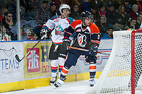KELOWNA, CANADA - DECEMBER 27:  Tyrell Goulbourne #12 of the Kelowna Rockets is checked by Sam Grist #3 of the Kamloops Blazers at the Kelowna Rockets on December 27, 2012 at Prospera Place in Kelowna, British Columbia, Canada (Photo by Marissa Baecker/Shoot the Breeze) *** Local Caption ***