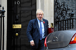© Licensed to London News Pictures. 30/10/2019. LONDON, UK.  Boris Johnson, Prime Minister, departs from Number 10 Downing Street for Prime Minister's Questions in Parliament.  MPs last night agreed to a General Election on 12 December, the first such winter election for nearly 100 years.  Photo credit: Stephen Chung/LNP