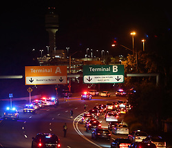 May 30, 2017 - Orlando, FL, USA - Police block access to the Orlando Interntional Airport, on May 30, 2017, after an armed man prompted the closure of Terminal A. (Credit Image: © Ricardo Ramirez Buxeda/TNS via ZUMA Wire)