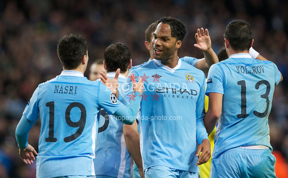 MANCHESTER, ENGLAND - Tuesday, Octover 18, 2011: Manchester City's Joleon Lescott celebrates his side's 1-1 goal with team-mate Samir Nasri against Villarreal CF during the UEFA Champions League Group A match at the City of Manchester Stadium. (Pic by Vegard Grott/Propaganda)