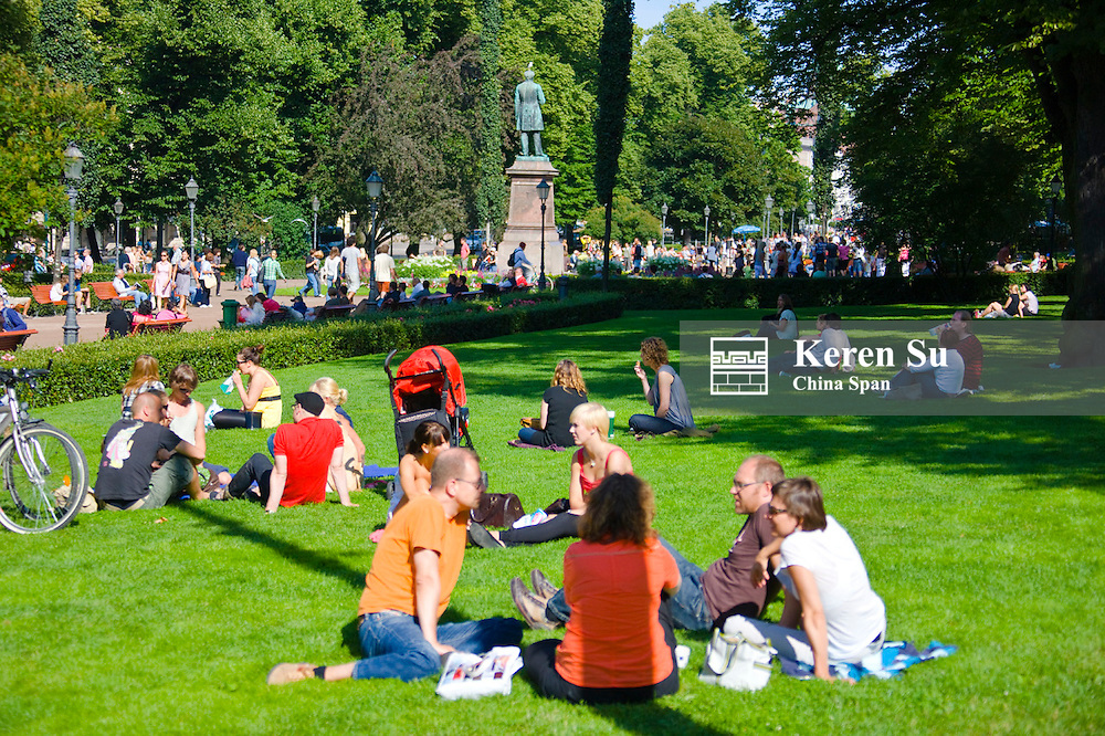 People relaxing in the Esplanade Park, Helsinki, Finland