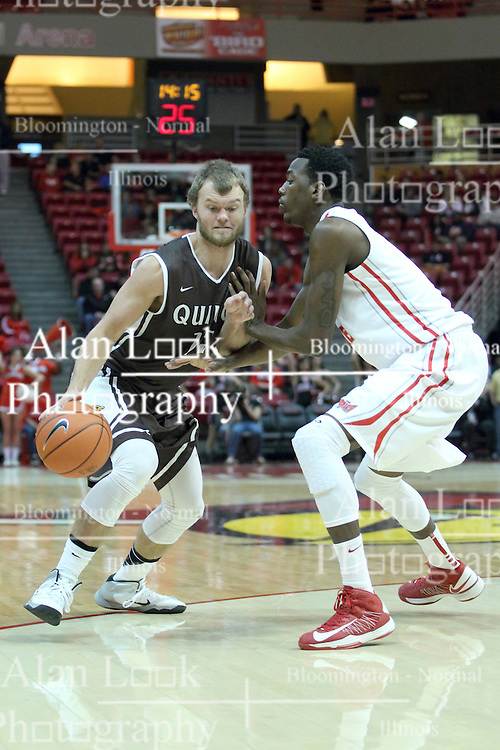03 November 2013:  Scott Hahn works against defender Jamaal Samuel during an mens exhibition basketball game between the Quincy Hawks and the Illinois State Redbirds in Redbird Arena, Normal IL