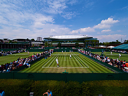 LONDON, ENGLAND - Thursday, July 5, 2018: A view of the outside courts looking on to Centre Court on day four of the Wimbledon Lawn Tennis Championships at the All England Lawn Tennis and Croquet Club. (Pic by Kirsten Holst/Propaganda)