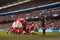 Football - Premier League - Manchester City vs. Arsenal<br /> Referee Mike Dean watches over Arsenal's celebrations following Laurent Koscielny's equalising goal at the Etihad Stadium