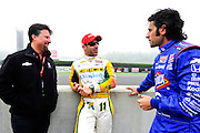 30 March - 1 April, 2012, Birmingham, Alabama USA.Michael Andretti, Tony Kanaan and Dario Franchitti chat before first practice. .(c)2012, Jamey Price.LAT Photo USA