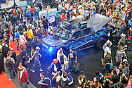 Manhattan, New York City, New York, USA. October 10, 2015. GAEMS Performance Gaming Monitors are set up on an EPIC electric vehicle, seen in an overhead view at the 10th Annual New York Comic Con. NYCC 2015 is expected to be the biggest one ever, with over 160,000 attending during the 4 day ReedPOP event, from October 8 through Oct 11, at Javits Center in Manhattan