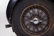 Found in a garage where it had been stored virtually untouched for 50 years, this 1937 Bugatti Type 57s Atalante sports car is previewed for the first time before a Bonhams auction in Paris on February 7th 2009. Here, we see a detail of the rusty spoked wheels in a garage/studio before the auction and sale in Paris. In 2008 the Bugatti Type 57S with chassis number 57502 built in 1937 with the Atalante coachwork for Earl Howe was discovered in a private garage in Newcastle upon Tyne, having been stored untouched for 48 years and known about only by a select few people. It was auctioned in February 2009 at the Retromobile motor show in Paris, France, fetching EUR3.4 million (US$4.6 million), becoming one of the highest valued cars in automotive history, owing much to its extremely low mileage, original condition and ownership pedigree.
