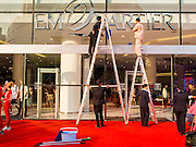"27 MARCH 2015 - BANGKOK, THAILAND: Workers clean the front window for ""EmQuartier,"" a new mall in Bangkok. ""EmQuartier"" is across Sukhumvit Rd from Emporium. Both malls have the same corporate owner, The Mall Group, which reportedly spent 20Billion Thai Baht (about $600 million US) on the new mall and renovating the existing Emporium. EmQuartier and Emporium have about 450,000 square meters of retail, several hotels, numerous restaurants, movie theaters and the largest man made waterfall in Southeast Asia. EmQuartier celebrated its grand opening Friday, March 27.    PHOTO BY JACK KURTZ"