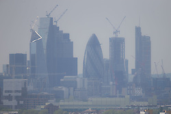 Sunbathers enjoy the hazy sunshine partially obscuring the City skyline in London, seen from Maze Hill, Greenwich as Mayor Sadiq Khan announces air toxicity alerts for the Capital. London, May 08 2018.