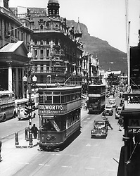 Adderley Street Trams.jpg <br /> In this 1939 picture, an electric double-decker tram trundles ponderously on rails past the Standard Bank building in Adderley Street. Opposite is one of the newer trams, which didn't need rails, and ran between Sea Point and the terminus in Wynberg. Fletcher & Cartwrights' department store can be seen at the junction of Adderley and Darling streets.<br /> ( Sea Point line doubledecker trams running through Adderley Street (1939) Picture: Cape Times)