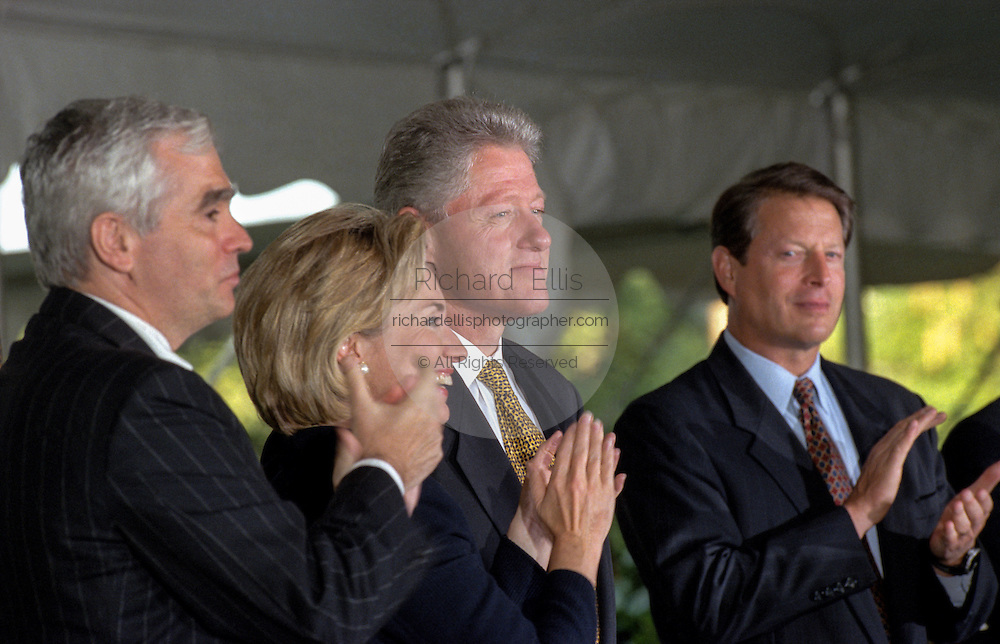 US President Bill Clinton is applauded by wife Hillary Clinton, Brian O'Dwyer and Vice-President Al Gore during a ceremony on the South Lawn of the White House September 11, 1998 in Washington, DC. Clinton received the Paul O'Dwyer Peace and Justice Award, for Clinton's work in helping bring peace in Northern Ireland. The ceremony took place the same day the Starr Report was released to Congress.