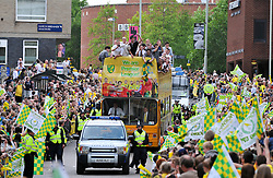 © licensed to London News Pictures. Norwich, UK  10/05/2011. Norwich City football club celebrate their promotion to the Premiere League by appearing on an open top bus as it drives along a route flanked by thousands of Norwich supporters. Please see special instructions for usage rates. Photo credit should read Alan Bennett/LNP